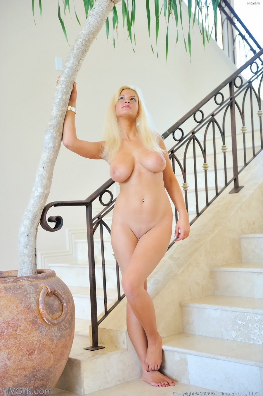 ... is a natural busty girl that just look amazing naked and masturbating